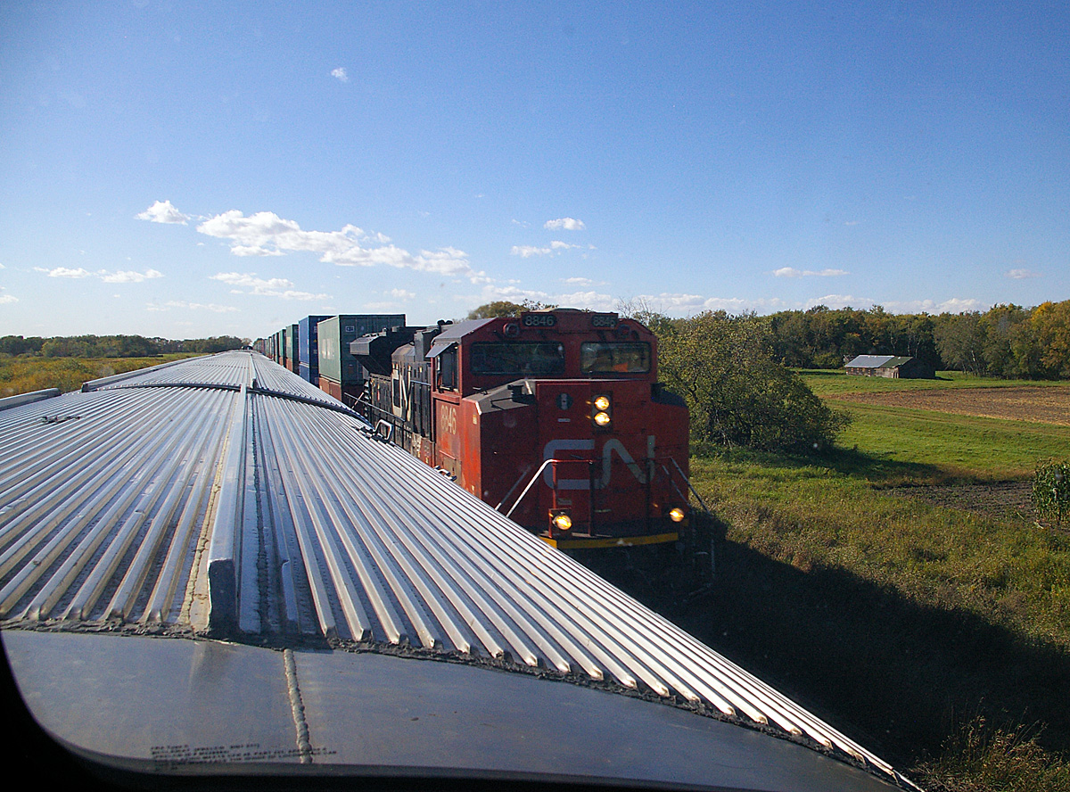 Passing an eastbound CN train, west of Winnipeg, Manitoba