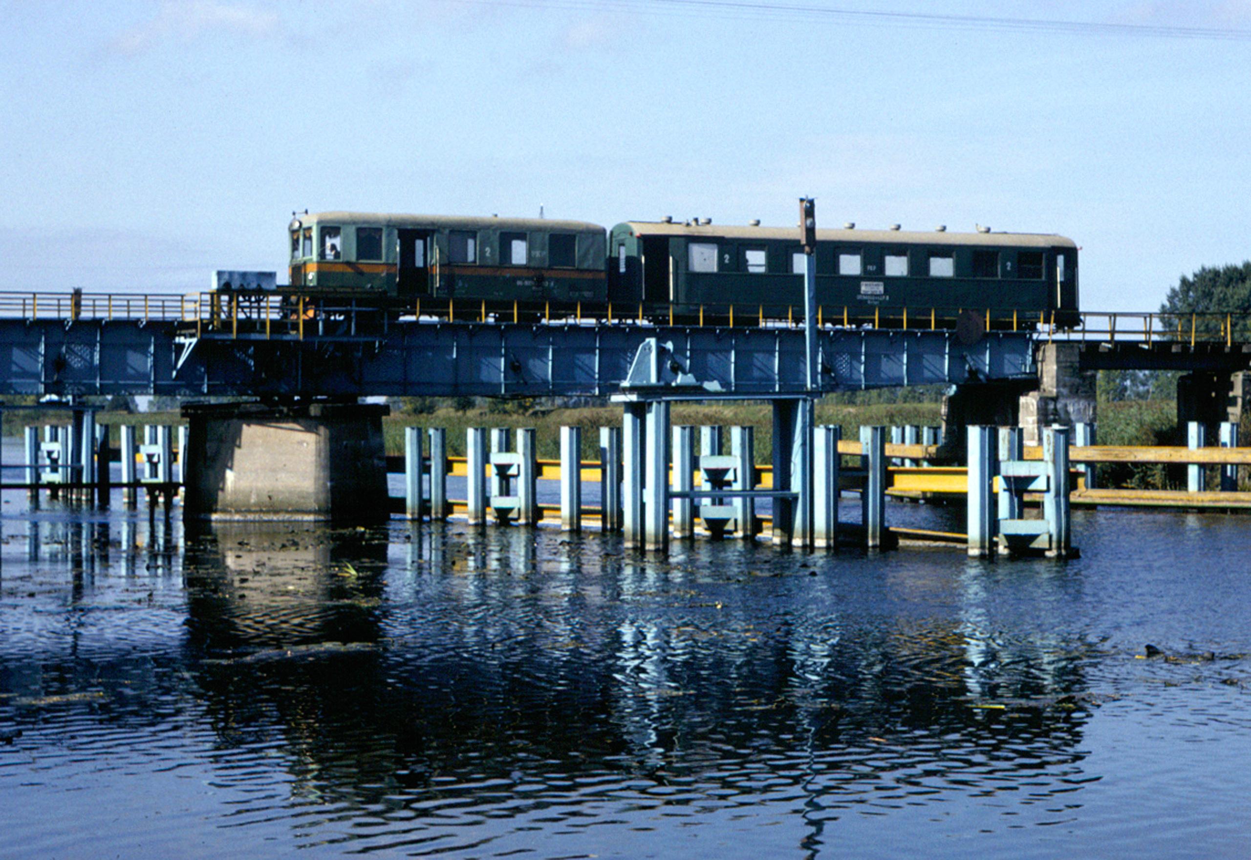 Crossing the Szkarpawa River on a swing bridge at Rybina
