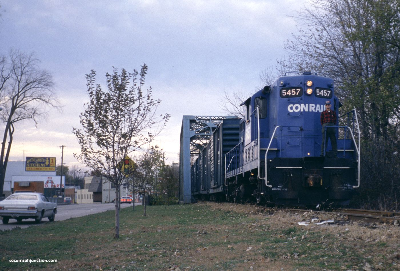 Conrail engineer Dale Stultz poses on Conrail GP-8 #5457 at Blissfield, Michigan on November 3, 1980.