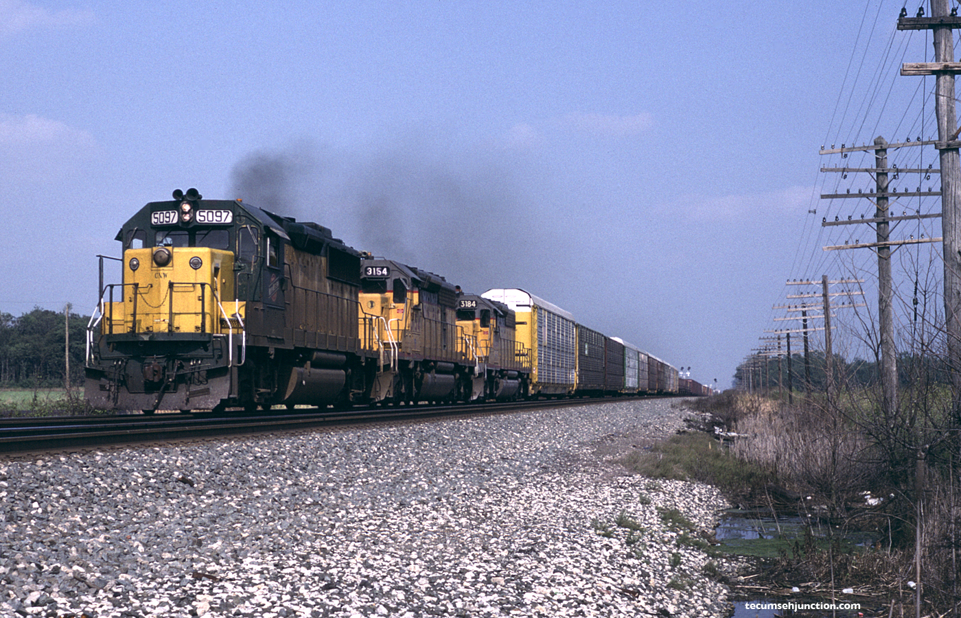 Westbound train with C&NW unit near Edgerton, OH