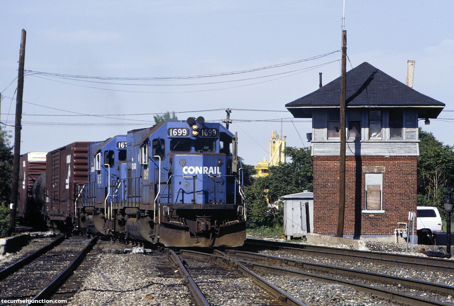 Conrail train passes Beaubien Tower on 16 June 1990.