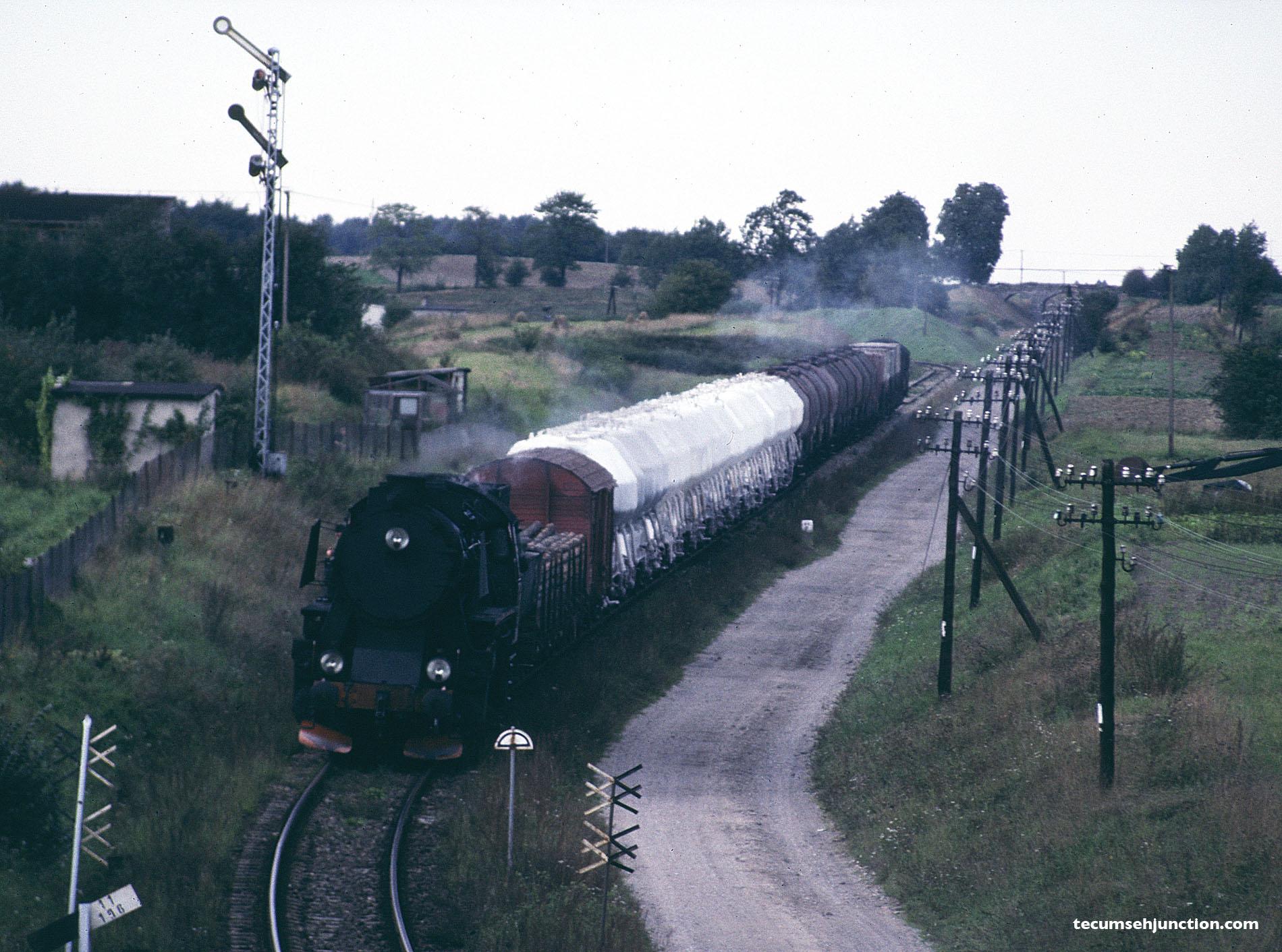 A PKP Ty2 or Ty42 arrives at Kościerzyna, Poland with a train from Lipusz