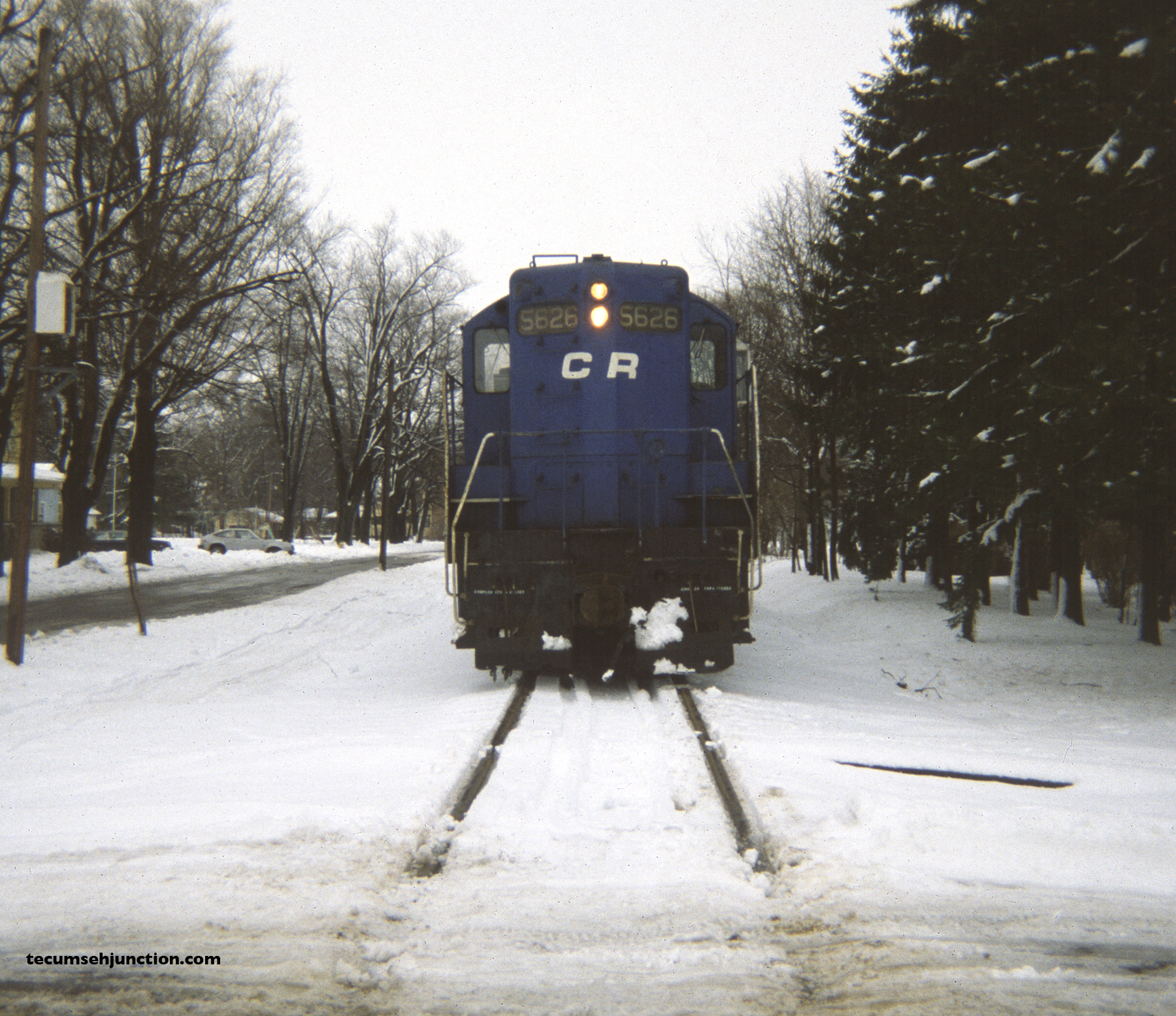 Conrail 5626 pauses for dinner at Blissfield, Michigan. (12 December 1981)
