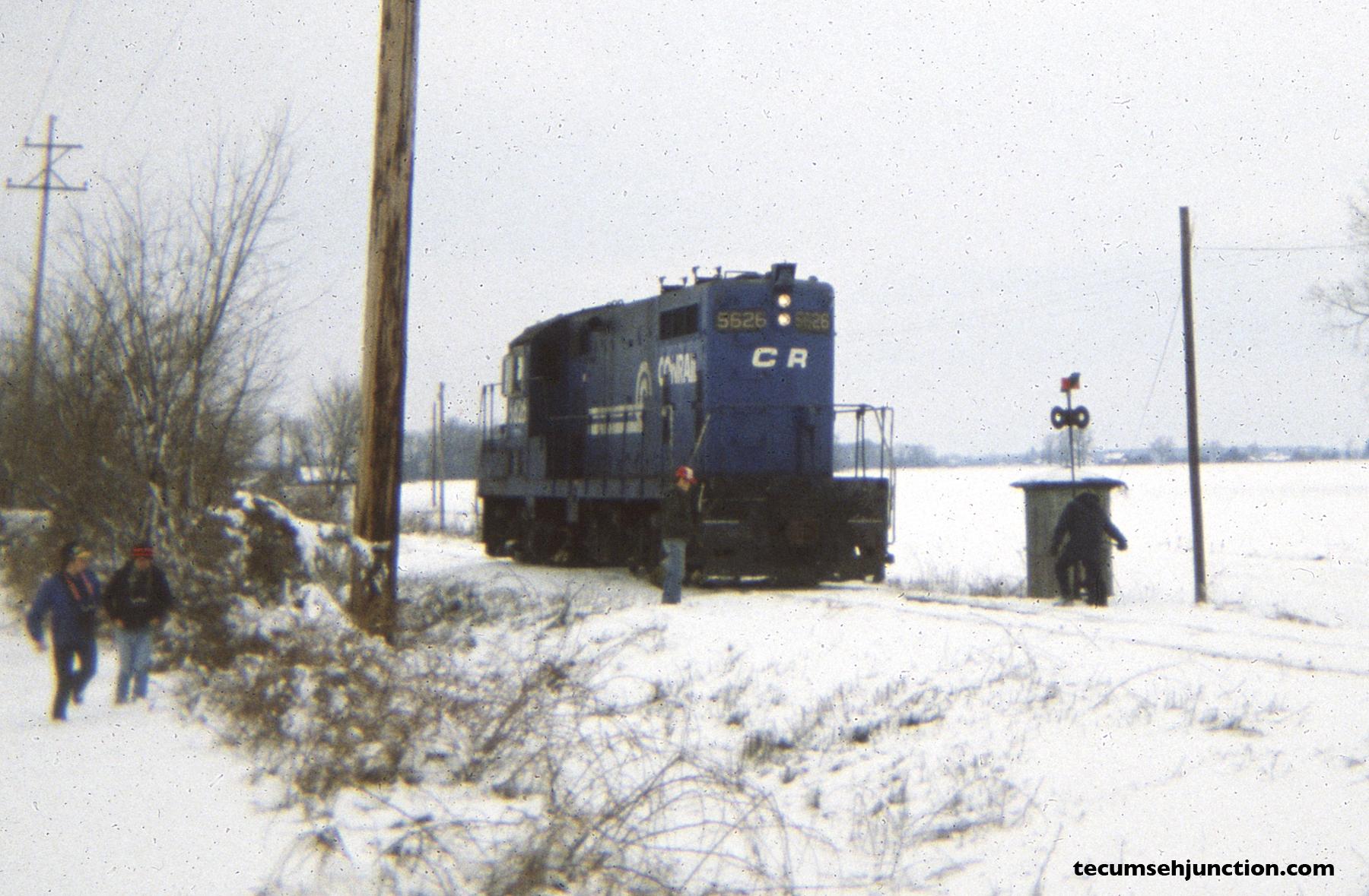 Conrail 5626 prepares to enter the siding at Grosvenor, Michigan. (12 December 1981)