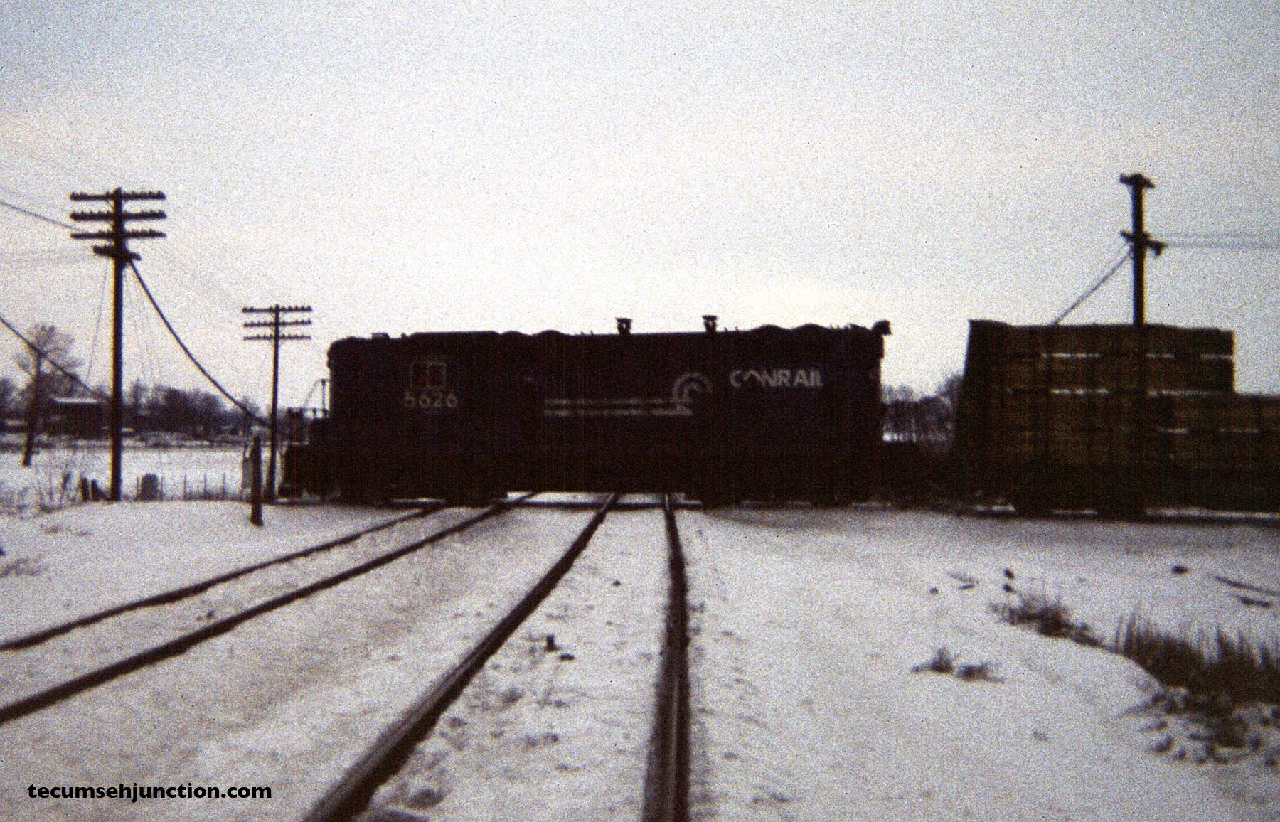 The northbound train crosses N&W diamonds at Raisin Center, Michigan. (12 December 1981)