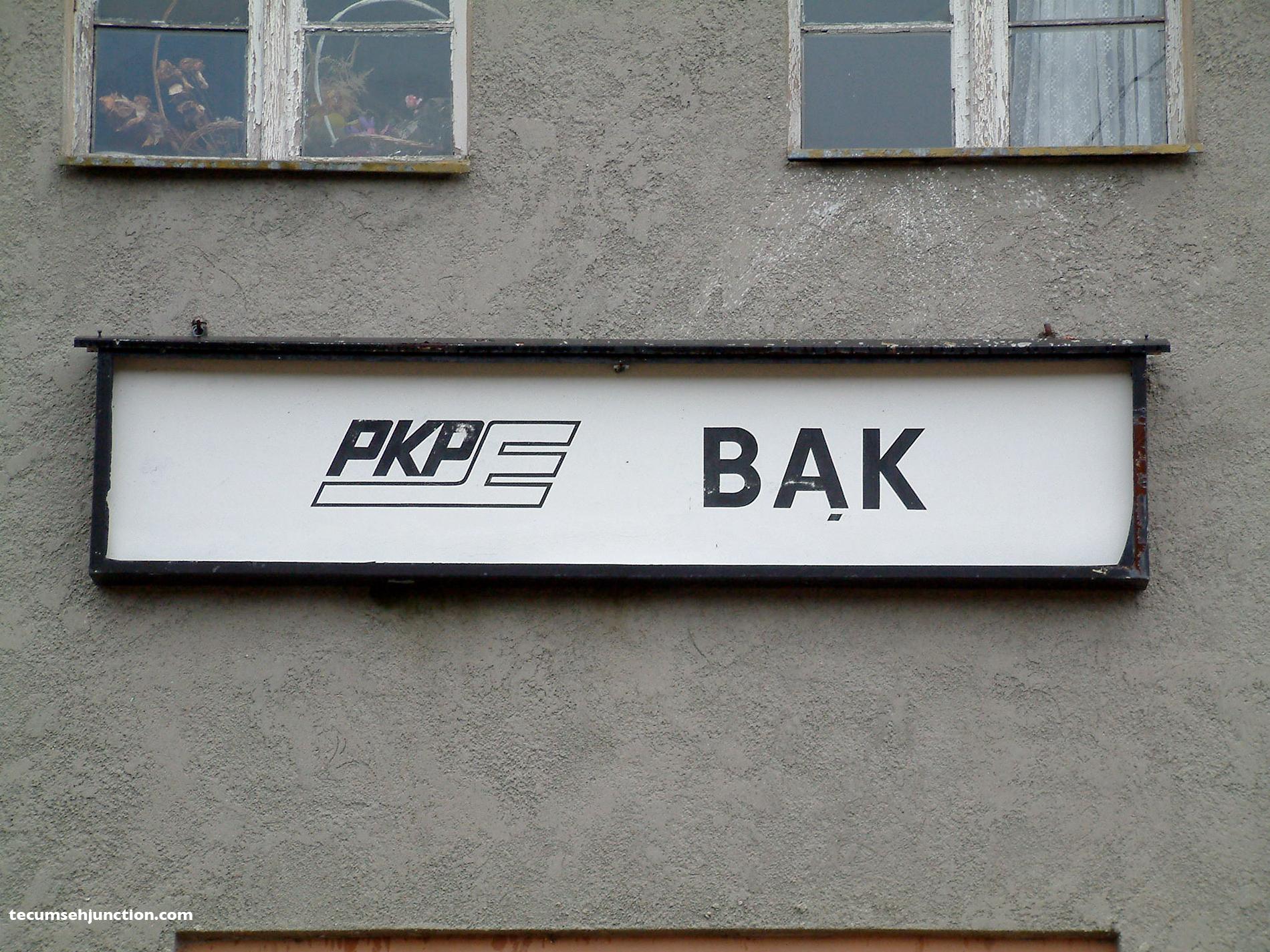 Bąk station sign