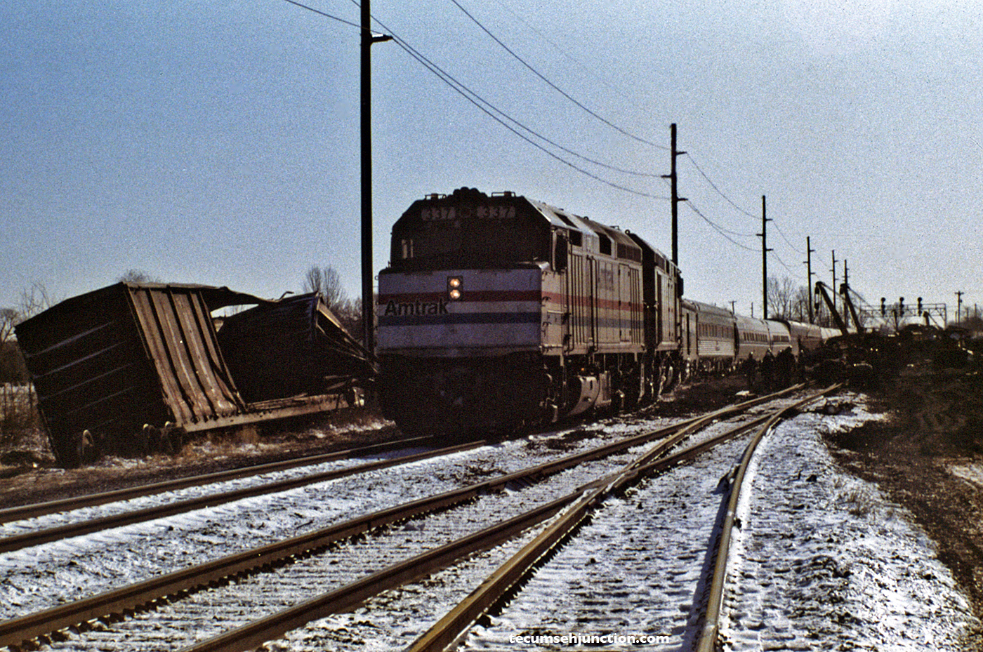 "Amtrak train #49, the westbound ""Lake Shore Limited"", passes the wreck site on a temporary shoe-fly track."
